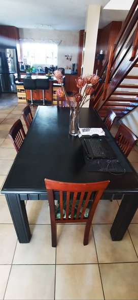 Solid Wood black Dining room table with 6 x chairs for free..