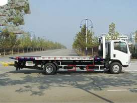 FLAT BED,CRANE AND TOWING TRUCKS
