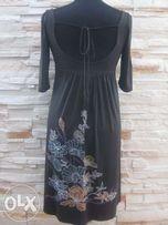 Porządki w szafie - Orsay efektowna sukienka rozm S