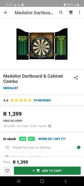 Dart board in cabinet with darts