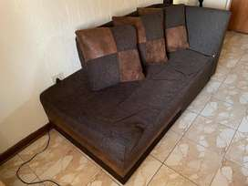 L shaped lounge suite with ottoman