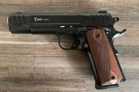 Colt 1911 with 20 rounds and a holster