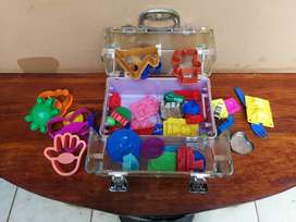 Collection of kids plastic dough cutters and moulds.