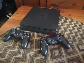 PlayStation 4 and two controllers