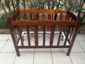 Beautiful old solid wood cot.