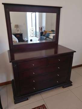 Chest of drawers and matching mirror.