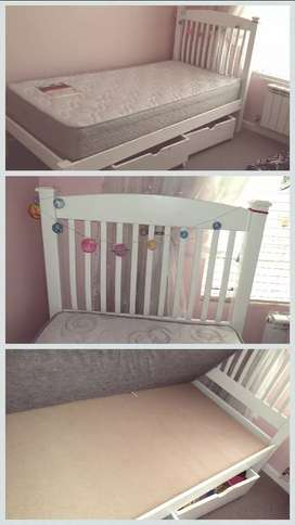 Single bed. With toy boxes