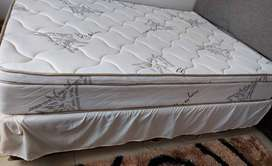 Bed with headboard and bar fridge
