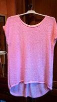 Różowa bluzka oversize idealna na lato firmy Takko,
