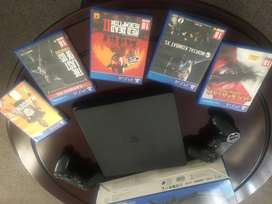 PS4 console with two controllers and 4 games