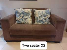 2 two seater couches 1 black fabric couchand 1 ottoman