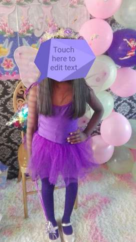 Girls second hand purple tutu dress with wings and stockings