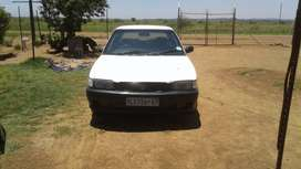 toyota tazz white in colour with mags paper in order still driving