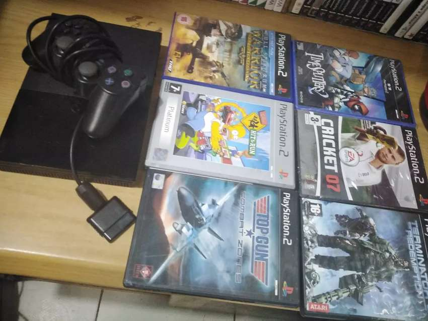 Ps2 console with 6 games