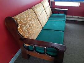 Three seater wooden couch for sale