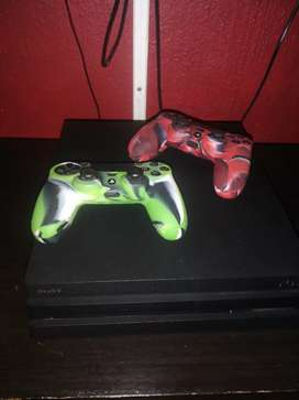 Ps4 pro +2 remotes and games