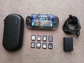 PSVita + 9 Games + Charger + Pouch