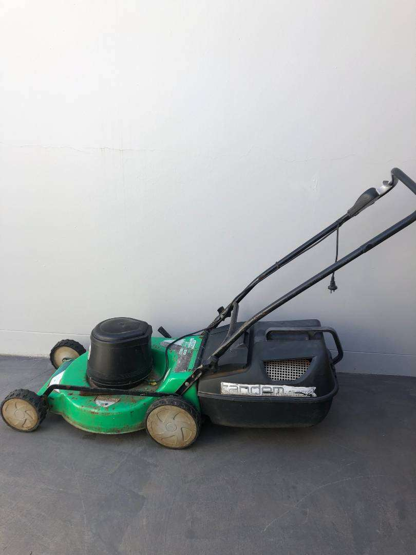 Aerovac Lawnmover and Trimtech Edgetrimmer 0