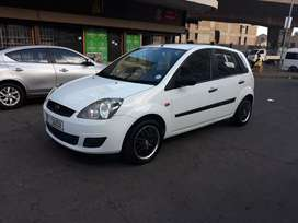 Ford Fiesta 1.4 hatchback white in color manual transmission