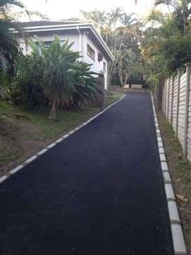 Tar Surfacing and Brick Paving.