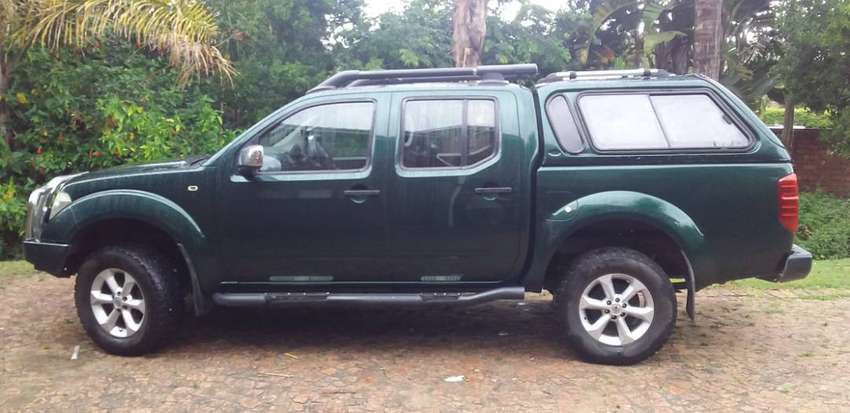 Nissan navara 4x4 4l v6 comes with service book and manual. 0