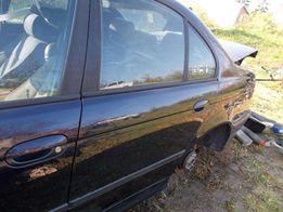 Drzwi E39 lewy tył orientblau Części e39 E34