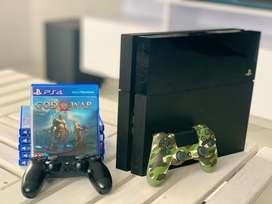 PS4 with 2 controls plus 6 games!
