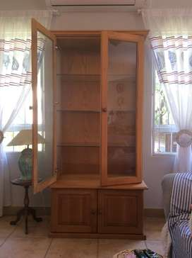 Oak display cabinet with glass shelves and doors