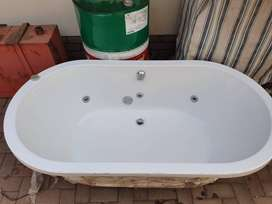 Jacuzzi, toilet shell and basin with stone