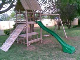 jungle gym and wooden fencing