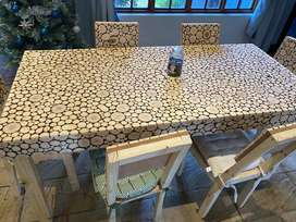 Hand crafted wooden Dining table with 6 chairs.