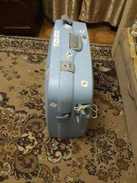Дорожній чемодан на ролїках