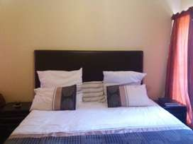 King size bed, headboard and pedestals
