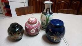 Assorted porcelain containers and vase