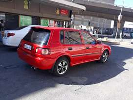 Toyota tazz 1.3 red in color hatchback