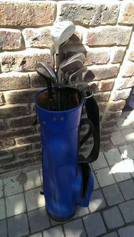 Golf clubs and bag. Missing an 8