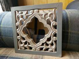 Small mirror with decorative frame