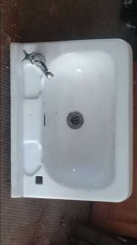 Basin and tap