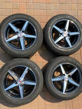 14 inch Mags complete with tyres and wheel nuts