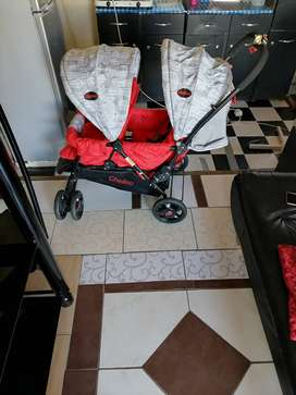 Chelino front and back twin pram