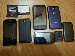 Смартфони на запчастини, зарядні та навушники до старих телефонів