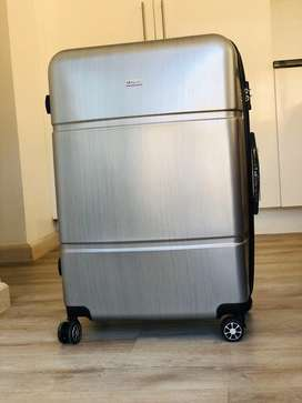 NEW! Not used - Large Silver traveling luggage