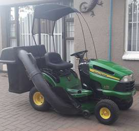 Ride on mower with canopy