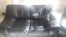Black leather lounge suite