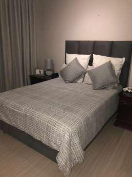 Double Bed + Base + Mattress. Incl decorative cushions, linen + inners