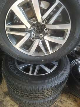 """18"""" Toyota/Fortuner Rims and 265/60/18 Dunlop AT."""