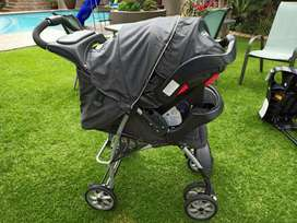 Graco Mirage 3 in 1 travel system. With a Graco car seat base
