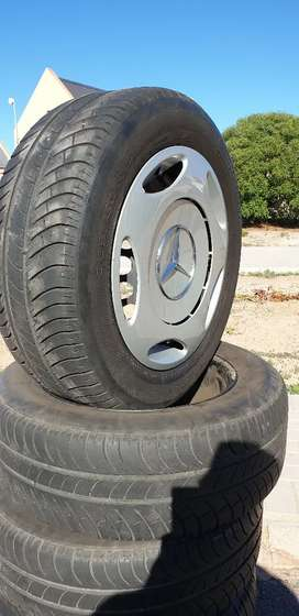 Mercedes-Benz  5 hole 15inch rims and hubcaps. For sale