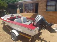 Image of Gazelle m-craft 60hp boat with accessories.