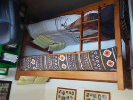 Bunk bed with mattress and bedding